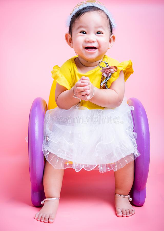 Asian princess little baby girl sitting on chair she is smile in studio royalty free stock photo