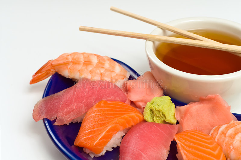 Asian Raw Fish Sushi Dinner w/ Shrimp Tuna Salmon. Asian Raw Fish Sushi Dinner w/ Shrimp, Tuna, Salmon, including rice, ginger, wasabi and soup royalty free stock photography