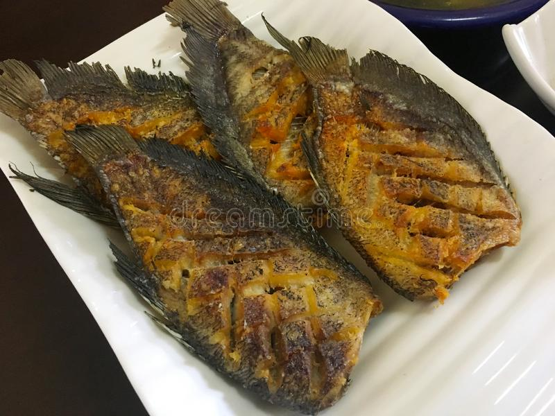 Asian recipe- Homemade fried fish - healthy seafood concept. Asian recopie, Homemade fried fish, healthy seafood concept royalty free stock image