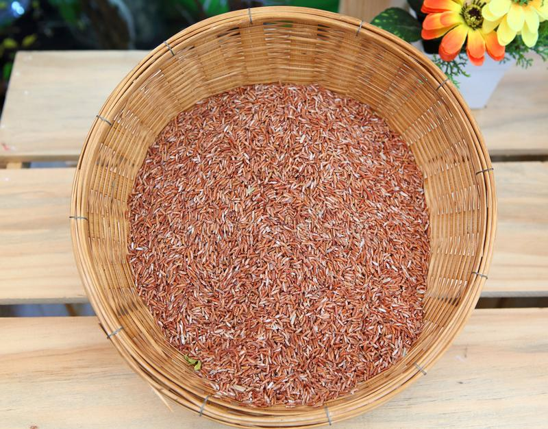 Asian red Jasmine rice in bamboo weave basket.  royalty free stock photos