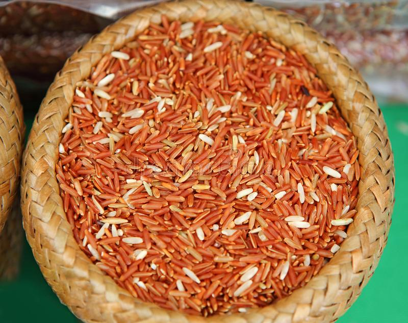 Asian red Jasmine rice in bamboo weave basket.  royalty free stock image