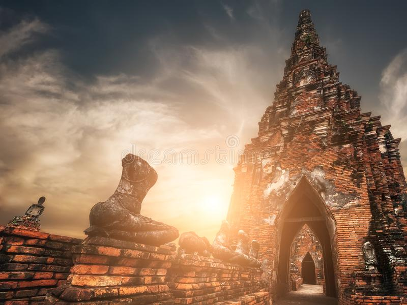 Asian religious architecture. Ancient Buddhist pagoda ruins at Chai Watthanaram temple under sunset sky. Ayutthaya, Thailand royalty free stock images