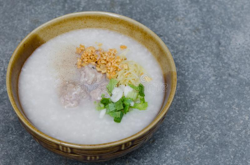 Asian Rice Porridge with Meatballs for Breakfast. Asian rice porridge with meatballs is a famous meal for breakfast royalty free stock photography