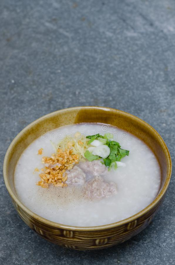 Asian Rice Porridge with Meatballs for Breakfast. Asian rice porridge with meatballs is a famous meal for breakfast royalty free stock images