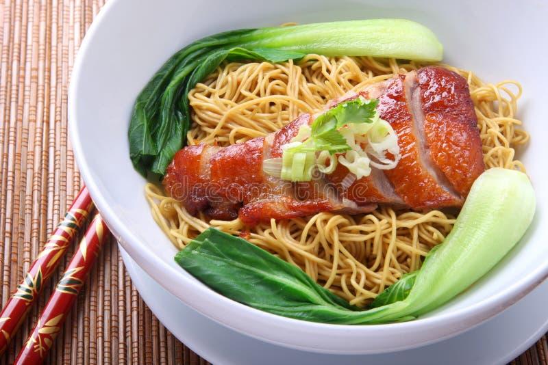 Asian Roast Duck Noodle. Oriental Peking Duck noodle soup royalty free stock photography