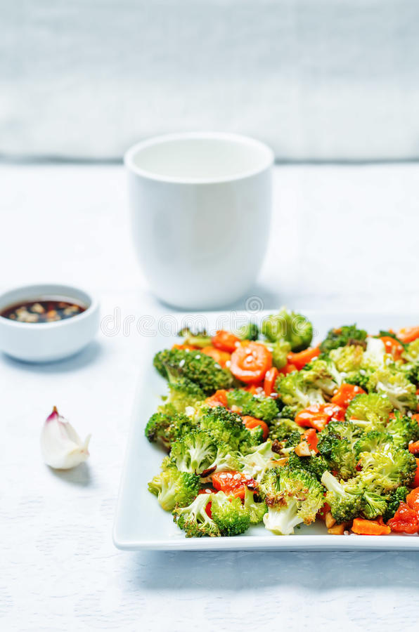 Asian roasted carrots and broccoli. Toning. selective focus royalty free stock images
