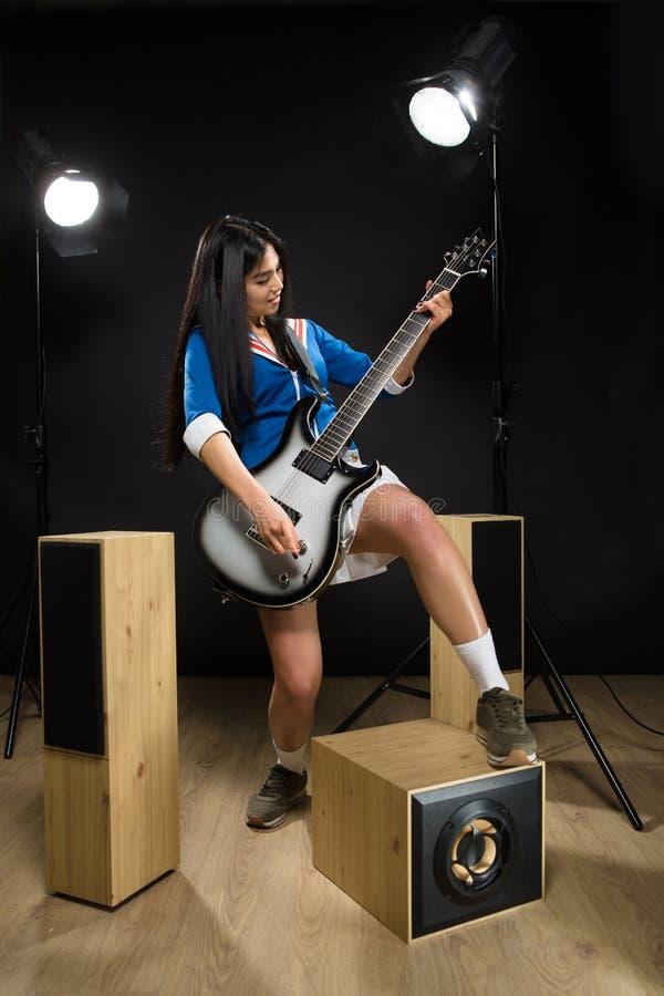 Asian rock star lady in studio stock photos