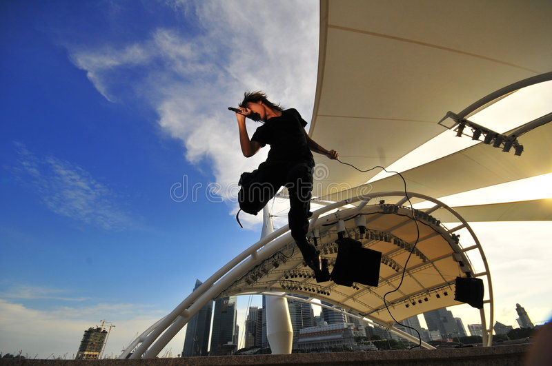 Asian Rock Star performing with city as backdrop stock images