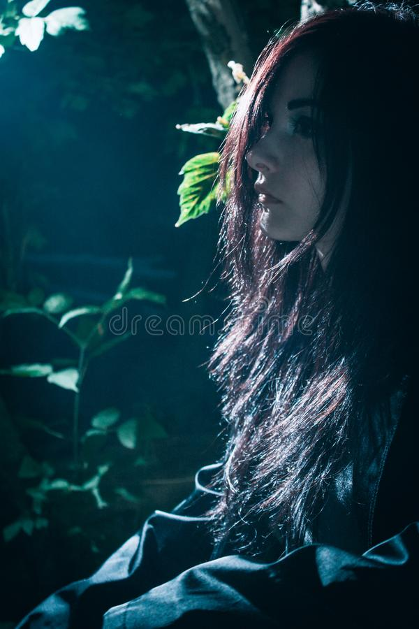 Asian rocker girl in a forest royalty free stock photo