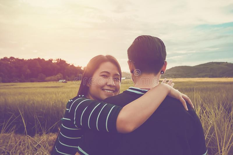 Asian,Romantic couple or Homosexuality, female love hug on the rice field with sunset. Valentine`s Day love concept stock image