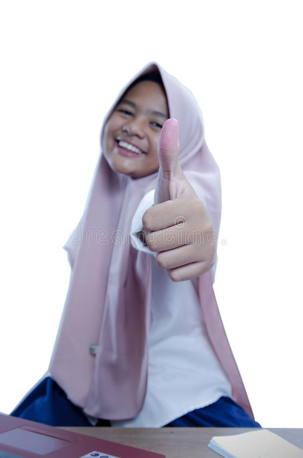 Asian`s businesswoman showing thumb up, wearing hijab, close up stock photos