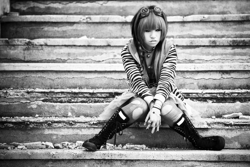 Asian sad lolita. Young asian sad girl with cosplay looking royalty free stock photo