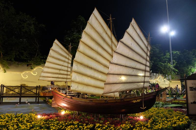 An Asian sailboat model exhibited among flowers at a Thai holiday stock photos