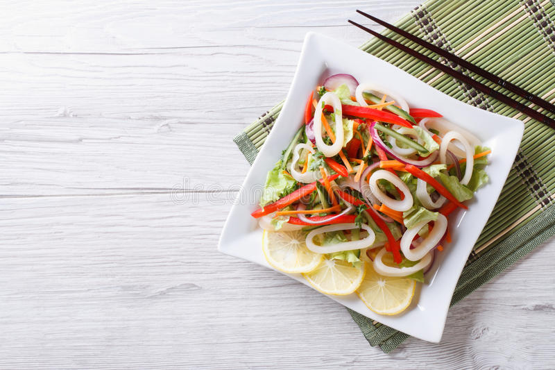 Asian Salad of squid with vegetables. horizontal top view royalty free stock images