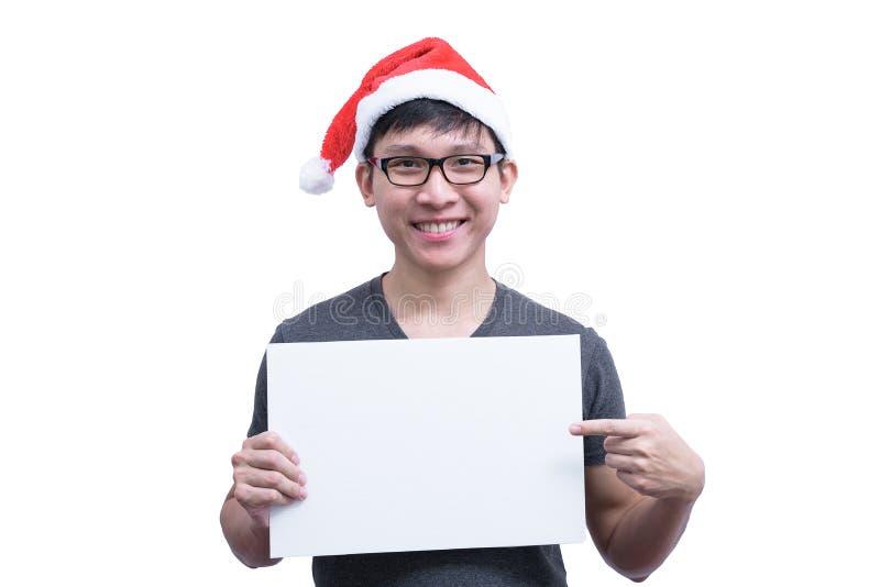 Asian Santa Claus man with eyeglasses and grey shirt has holding stock image