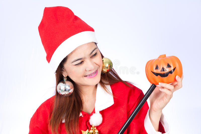 Asian santa women looking at halloween pumpkin stock images