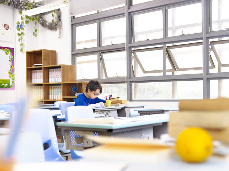 Asian school boy studying in classroom royalty free stock photo
