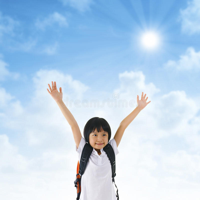 Asian school girl arms up in the air royalty free stock photos