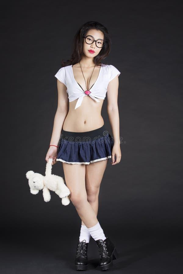Asian School girl with Teddy Bear stock photo