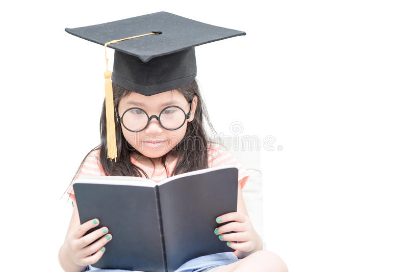 Asian school kid graduate reading book with graduation cap isolated royalty free stock photography
