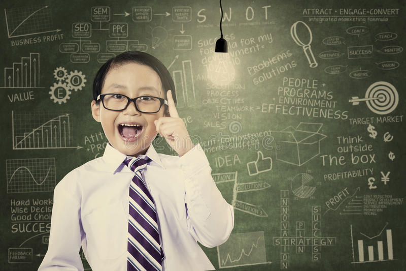 Asian schoolboy has an idea royalty free stock photography