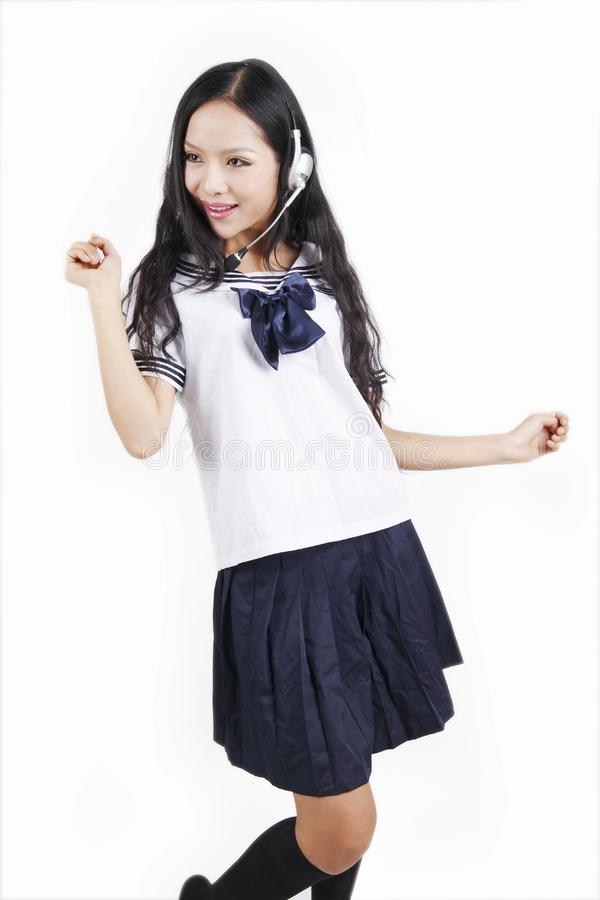 Asian schoolgirl enjoying music