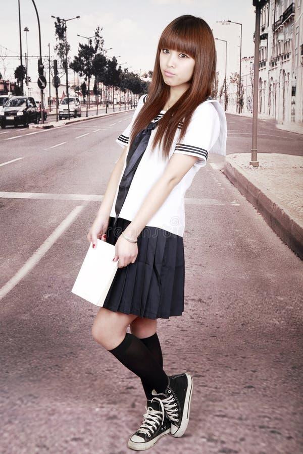 Asian schoolgirl outdoors.