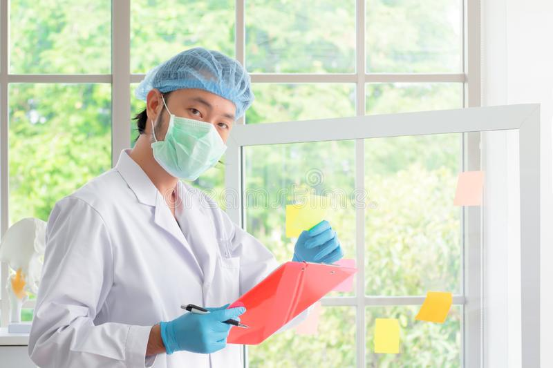 Asian scientist men checking and gathering data stock image