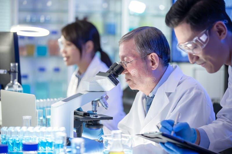 Asian scientist team meeting stock image