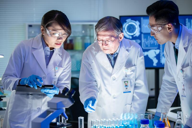 Asian scientist team meeting royalty free stock photography