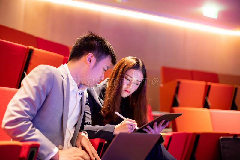 Asian secretary showing manager project report royalty free stock images