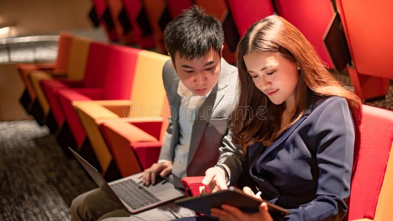 Asian secretary showing manager project report stock photography