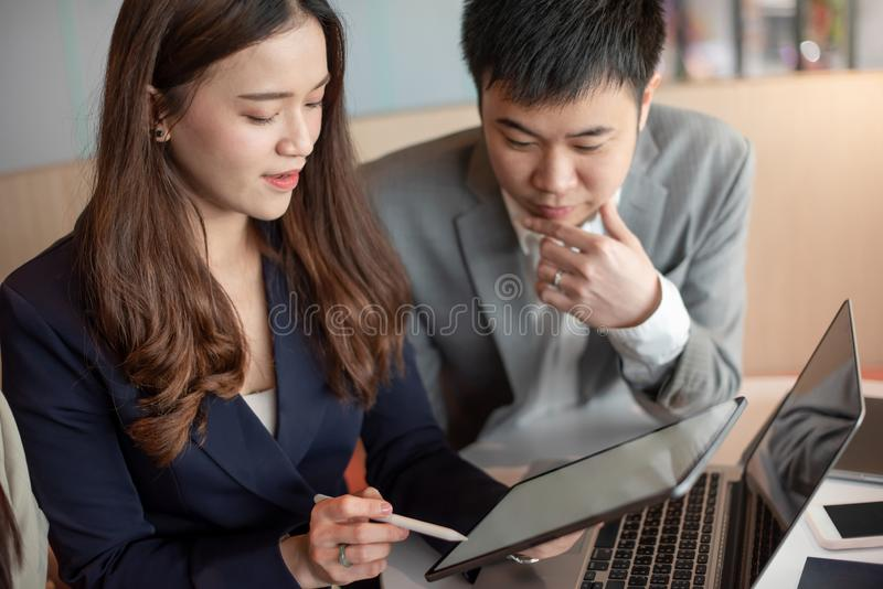 Asian secretary showing manager project report stock photos
