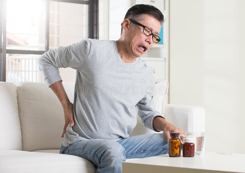 Asian senior with back pain stock photos