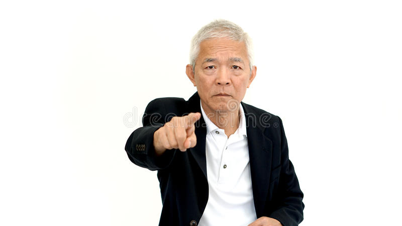 Asian senior business man wearing suit pointing with upset expre royalty free stock photography