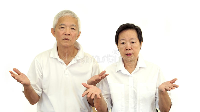Asian senior couple do not like a deal. Upset and do not satisfy. Asian senior couple do not like a deal. Upset do not satisfy royalty free stock photography