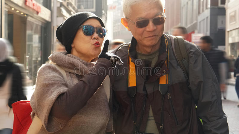Download Asian Senior Couple Having Fun In Europe Retirement Anniversary Stock Photo - Image of retired, outdoors: 92570220