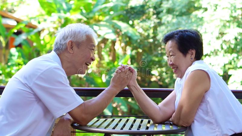 Asian senior couple play together happy game of relationship. Together royalty free stock photo