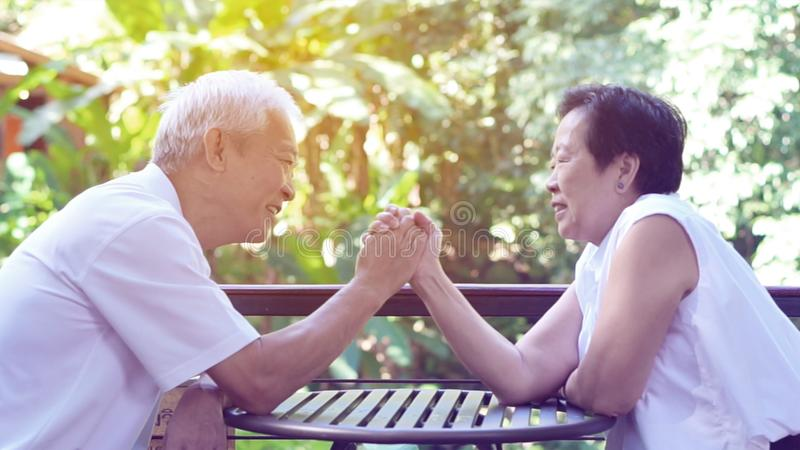 Asian senior couple play together happy game of relationship. Together royalty free stock image