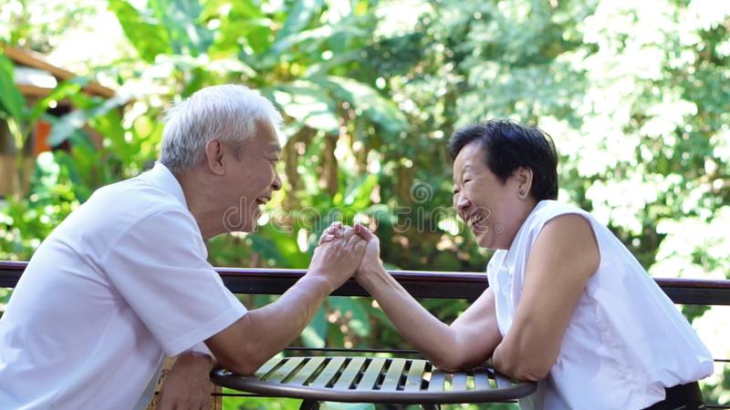 Asian senior couple play together happy game of relationship. Together stock photo