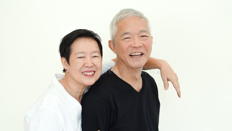 Asian senior couple smile, life with no worry on white background stock photography