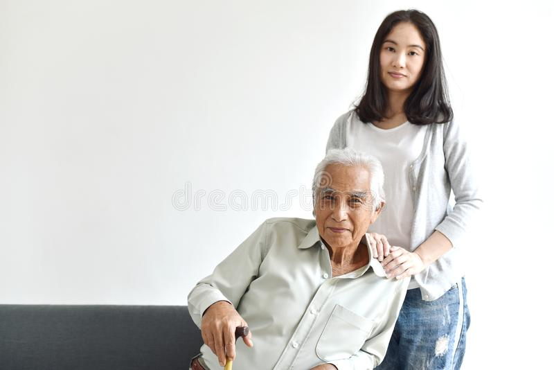 Asian senior father and adult daughter, Taking care of old parents, Happy family relationship. royalty free stock photos