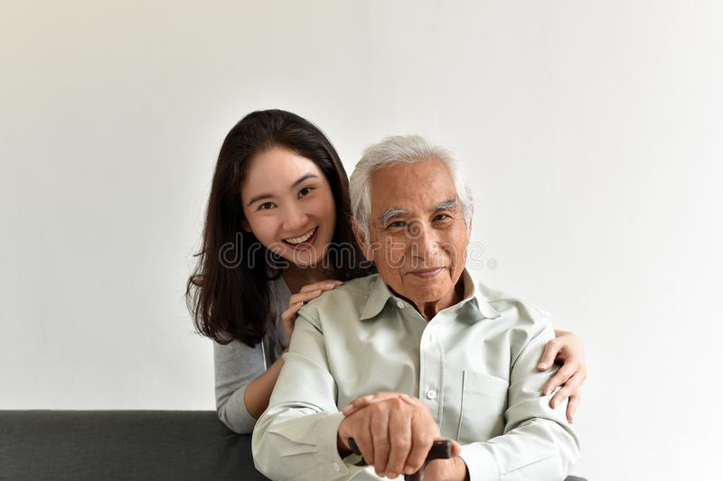 Asian senior father and smiling daughter, Happy family relationship. Asian senior father and smiling daughter, Happy family relationship, Elderly home nursing royalty free stock photo