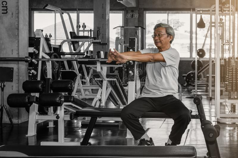 Senior male work out in gym stock images