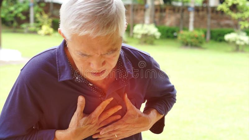Asian senior man chest pain heart attack stroke health care. Asian senior man chest pain heart attack stroke royalty free stock images