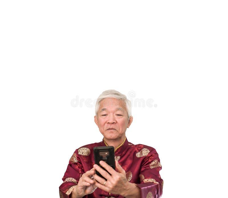 Asian senior man selfie for Chinese New Year greeting message. Asian senior man selfie for Chinese New Year greeting royalty free stock images