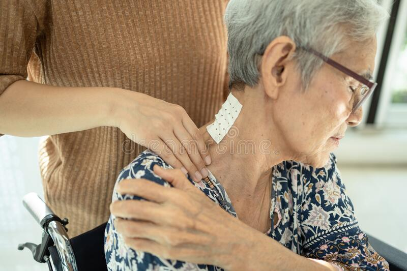 Asian senior mother have nerve pain,shoulder ache,neck pains,female caregiver or daughter massaging her shoulders, frustrated stock photos