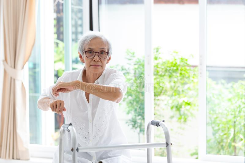 Asian senior people sitting relax with walker during rehabilitation,elderly woman wear glasses,exercise and looking at camera in stock photos