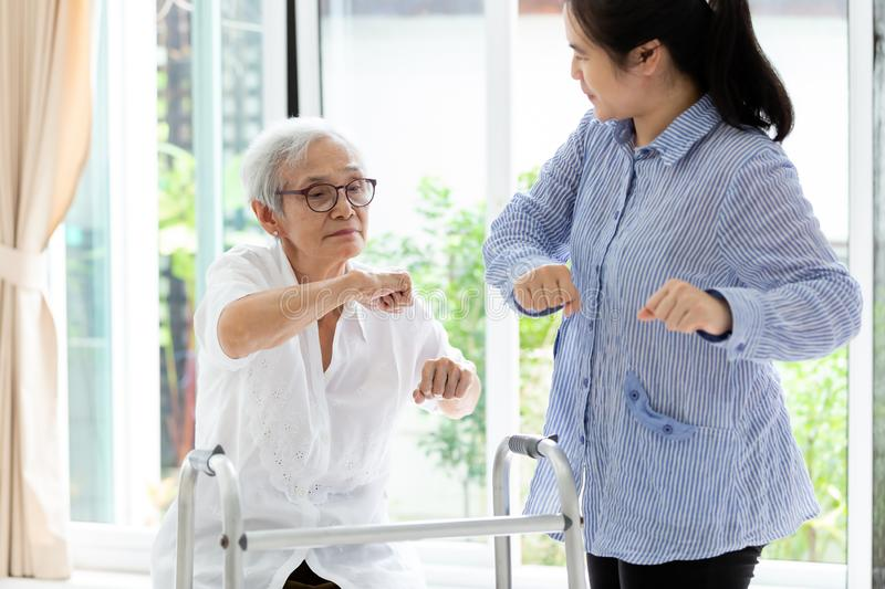 Asian senior people sitting relax with walker during rehabilitation and young carer,elderly woman or mother smiling and exercise stock photos