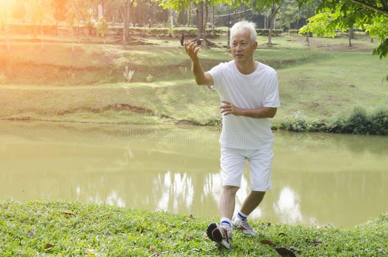 Asian senior tai chi outdoor stock photography